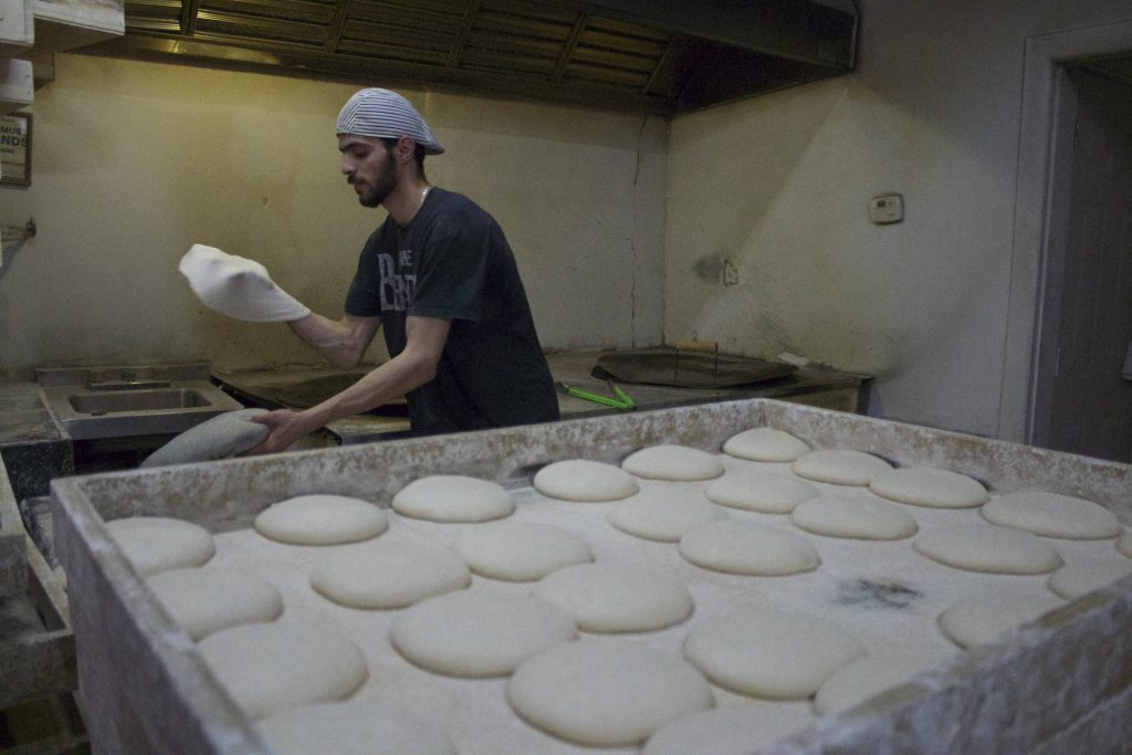 Baking bread at West Ridge's Baghdad Bakery.